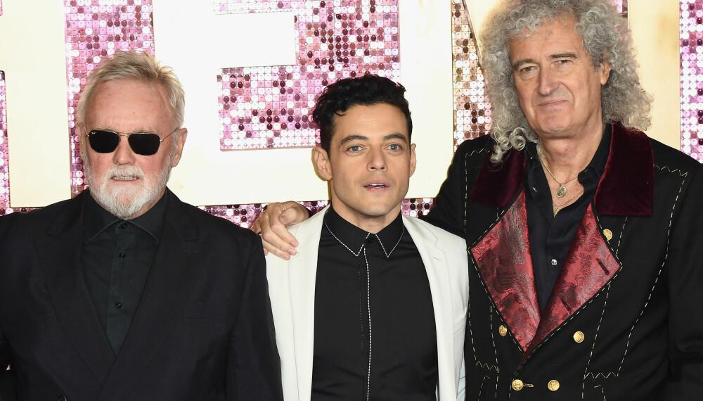 MELLOM TO LEGENDER: Roger Meddows-Taylor, Rami Malek som spiller Freddie Mercury i filmen om hans liv, «Bohemian Rapsody», og Brian May.