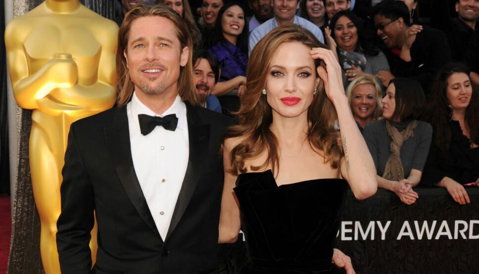 LIGNER: Eksparet Brad Pitt og Angelina Jolie med nesten lik frisyre.
