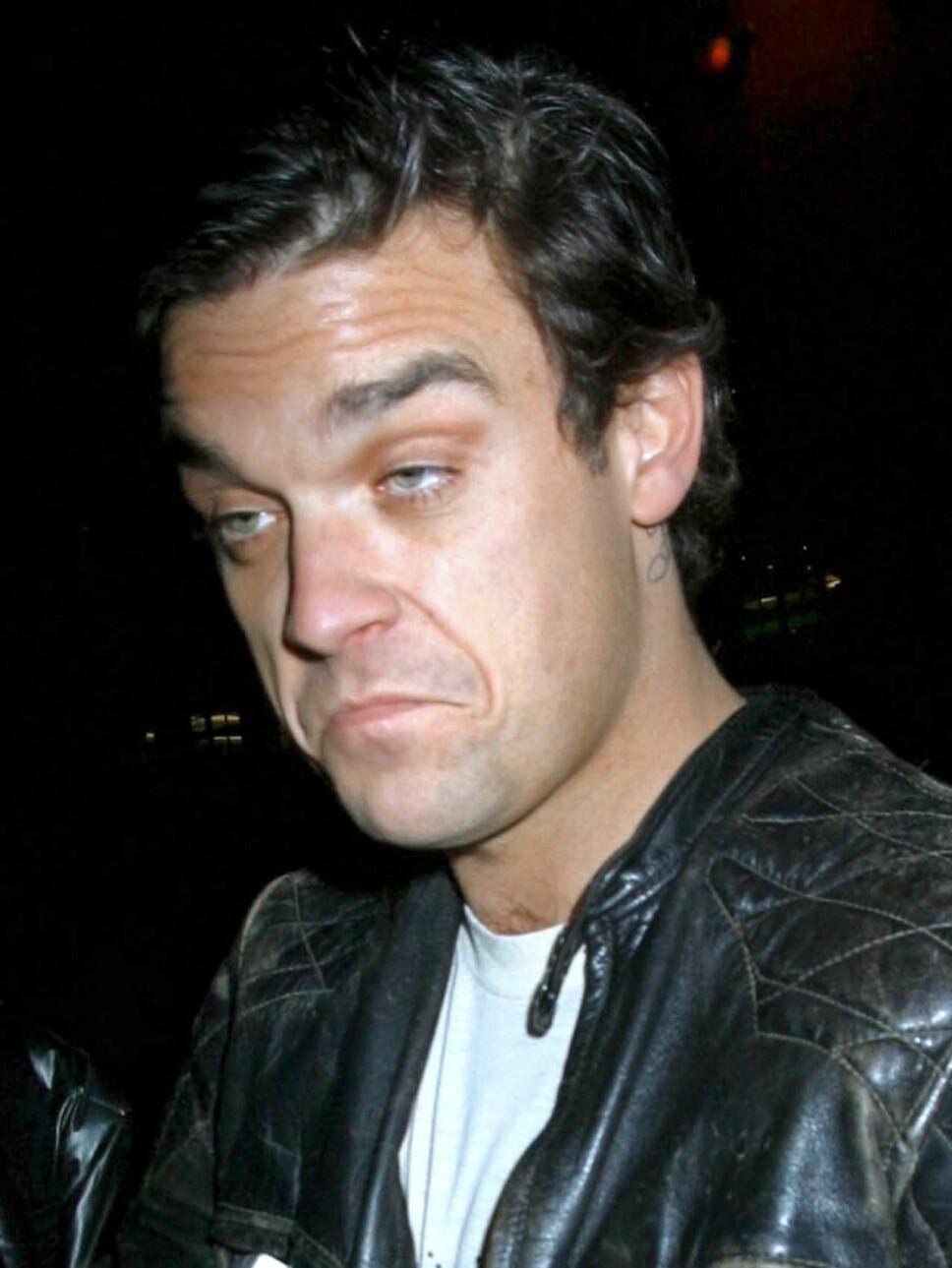 MØRK FORTID: Robbie har aldri lagt skjul på at han har slitt med depresjoner, og dermed søkt trøst i alkohol og narkotika.