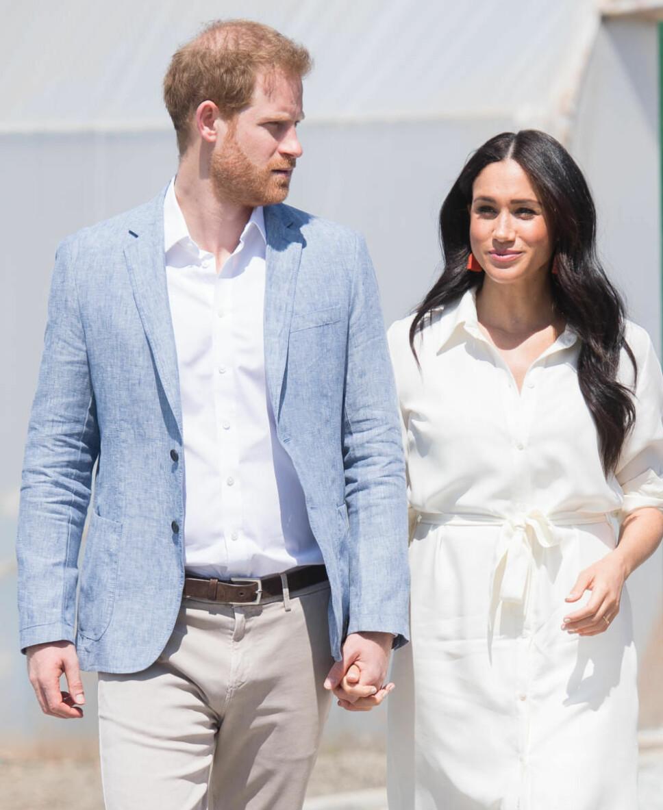 PASSER PÅ: Prins Harry gjør alt han kan for at kona Meghan skal ha det bra. Han frykter at presset fra mediene skal bli for tøft for henne å takle.